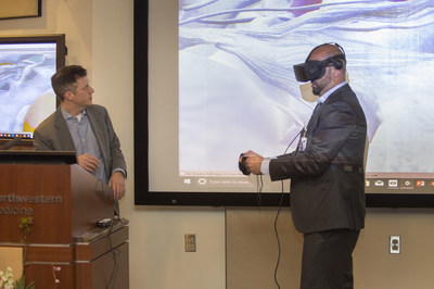 Neurosurgeons Dr. Michael Walsh (left) and Dr. Osaama Khan (right) demonstrate how virtual reality can be used to plan for surgery during the Northwestern Medicine Innovation Grant Challenge Final Event. The surgeons and their team won $50,000 to develop a project aimed at enhancing patient engagement through use of advanced video platforms.