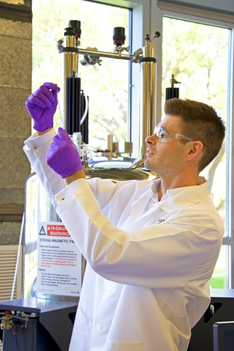 Dr. Sullivan preparing for Nuclear Magnetic Resonance (NMR) spectroscopy