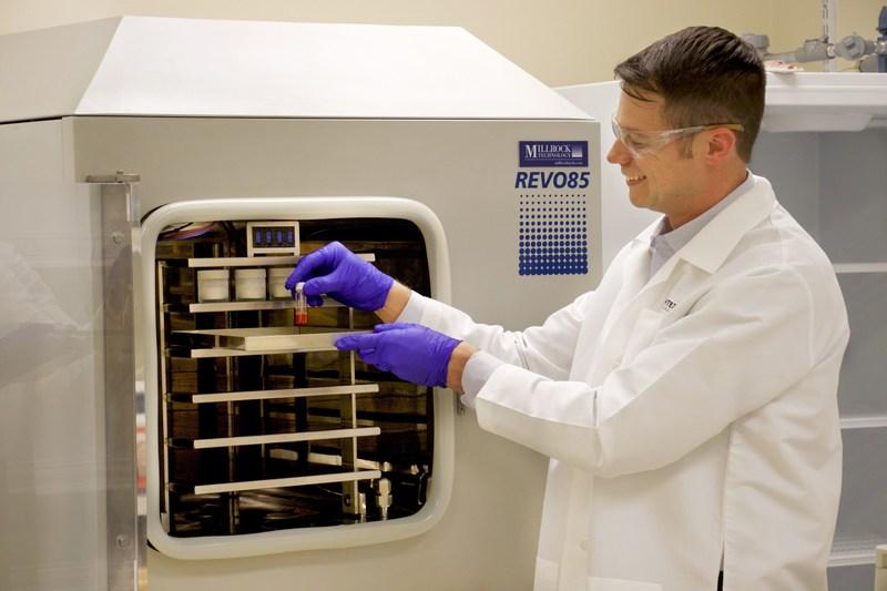 Dr. Carie preparing samples at the lyophilizer
