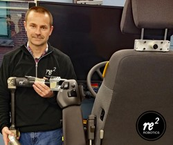 RE2 Robotics' Principal Project Engineer, Allen Bancroft, poses with an RE2 robotic arm and the RADR-T simulator in the Company's robotics lab.