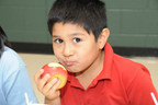 Picture of a student eating an apple