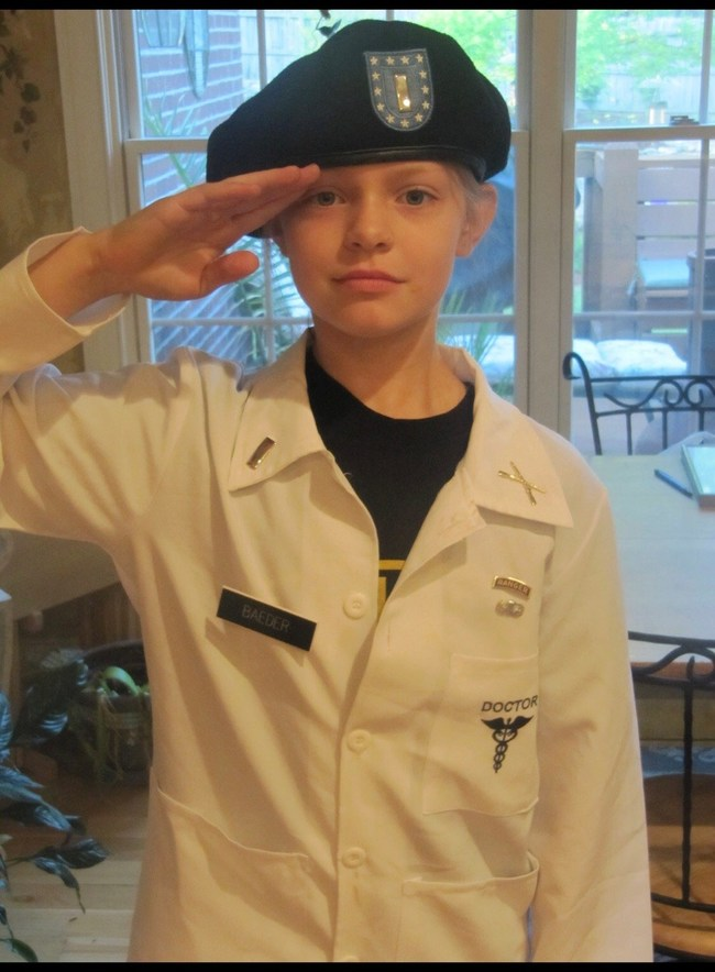 "In a picture taken for her 5th grade ""Career Day"" Baeder wore her father's beret, ranger t-shirt and a lab coat decorated with her father's military insignia. ""In joining the Long Gray Line, I am honored to continue the military legacy of my father, grandfathers and great-grandfathers, who all served in the military,"" says Baeder, who is the reigning Miss America's Outstanding Teen. She will attend the U.S. Military Academy at West Point this fall for military leadership training."