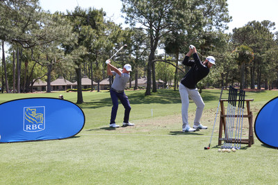 Johnson and Saunders both take swings using old Arnold Palmer branded clubs and balls. (CNW Group/RBC)