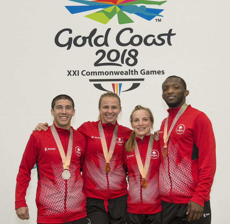 4 medals for wrestling today at the 2018 Commonwealth Games: gold for Erica Wiebe and Diana Weicker, silver for Steven Takahashi and Jevon Balfour. (CNW Group/Commonwealth Games Association of Canada)