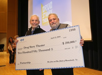 Andrew Dreyfus, president and CEO of Blue Cross Blue Shield of Massachusetts, presents Dr. Joseph Shrand with a $250,000 check to support the expansion of Drug Story Theater to more than 60 school districts (PRNewsfoto/Blue Cross Blue Shield MA)