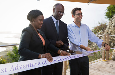 Prime Minister Leona Romeo-Marlin, Governor Dr. Eugene Holiday, Rainforest Adventures president Josef Preschel (left to right) taking part in a ribbon cutting ceremony to mark the official grand opening of the Rockland Estate eco-park attraction in St. Maarten.