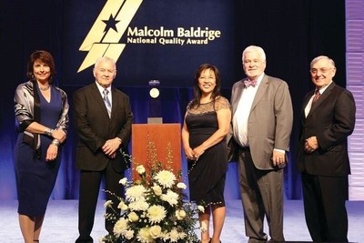 Southcentral Foundation President/CEO Dr. Katherine Gottlieb and members of the SCF Board of Directors accept the Malcolm Baldrige Award. From left: Karen Caindec, James Segura, Dr. Katherine Gottlieb, Dr. Terry Simpson and Charles Akers.
