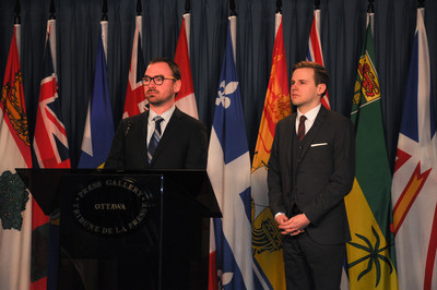 Michael Powell and Christian von Donat launch cryptogiving.ca on Parliament Hill. The website connects donors interested in giving cryptocurrency with charities that accept it. (CNW Group/Cryptogiving.ca)