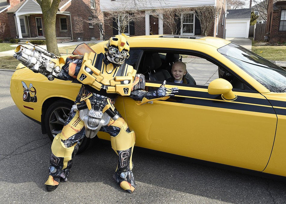 Beaumont Hospital, Royal Oak pediatric patient Hudson Brown poses with a Transformers character after completing proton therapy treatment at the hospital in Michigan.
