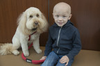 Hudson Brown and his therapy dog, Maddie, at Beaumont Hospital, Royal Oak's Proton Therapy Center in Michigan.