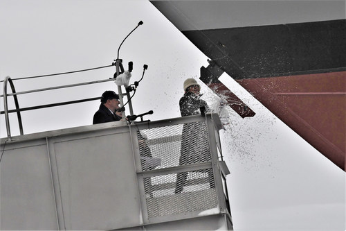 Ship sponsor Jill Donnelly breaks a bottle of champagne across the bow during the christening ceremony for the nation's 17th Littoral Combat Ship, the future USS INDIANAPOLIS, at the Fincantieri Marinette Marine shipyard on April 14.