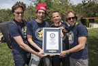 """Dominic Cunningham-Reid, Producer; Taran Davies, Producer; George Duffield, Producer; Daniel Ferguson, Writer, Director accept the GUINNESS WORLD RECORD title for """"Largest dog photo shoot."""""""