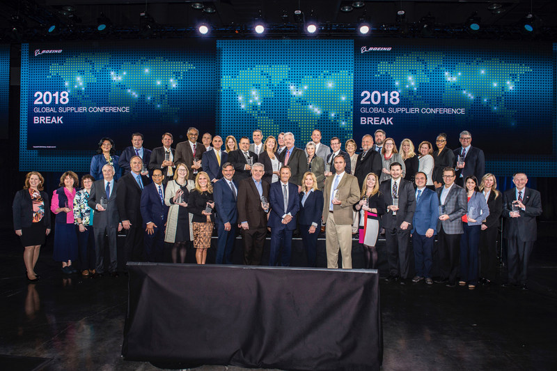 Kelly Ireland (bottom center) poses with other award recipients at the 2018 Boeing Global Supplier Conference