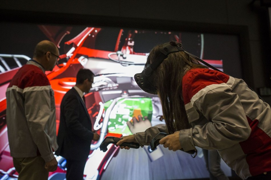 By using 3D glasses and a few controls, technicians imitate and analyse the movements made by workers on the assembly line. (PRNewsfoto/SEAT)