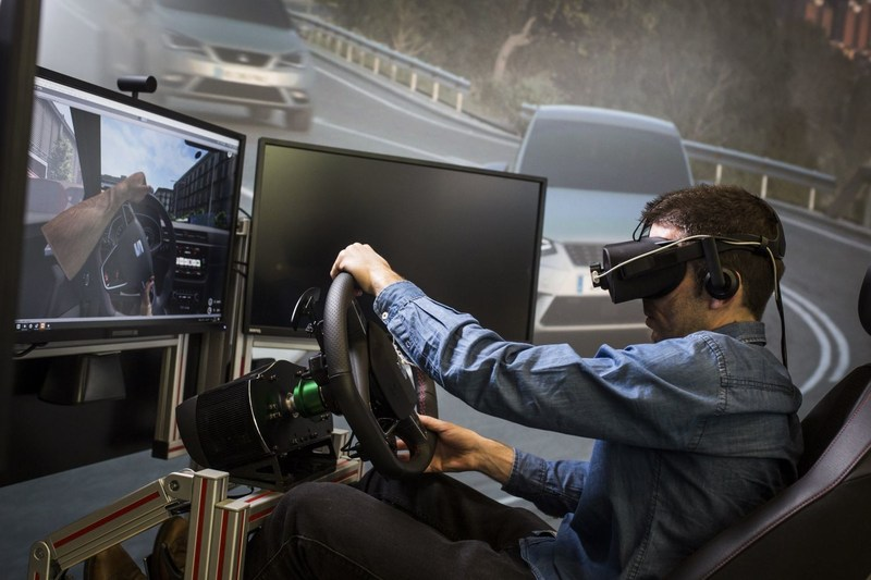 Designers with Full HD glasses enable them to immerse themselves in a driving experience that is similar to what future customers will have. (PRNewsfoto/SEAT)