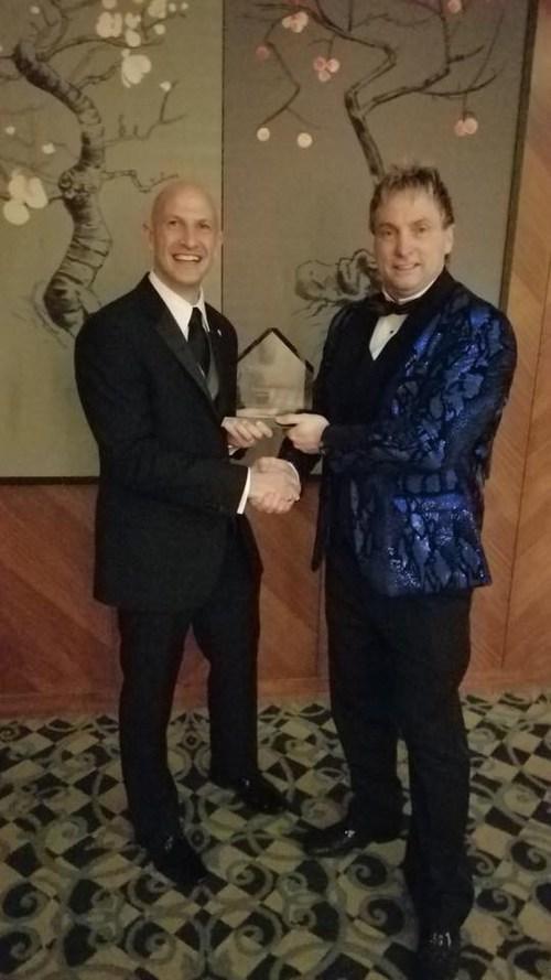 Realtors Care Award presented to John Patricelli