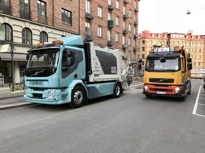 The new Volvo FL Electric with refuse application delivered to first customer in Gothenburg. Together with older refuse truck model. The quiet and clean all-electric driveline allows transports also at night to reduce congestions at day. Photo: INFOkontor (PRNewsfoto/INFOkontor)