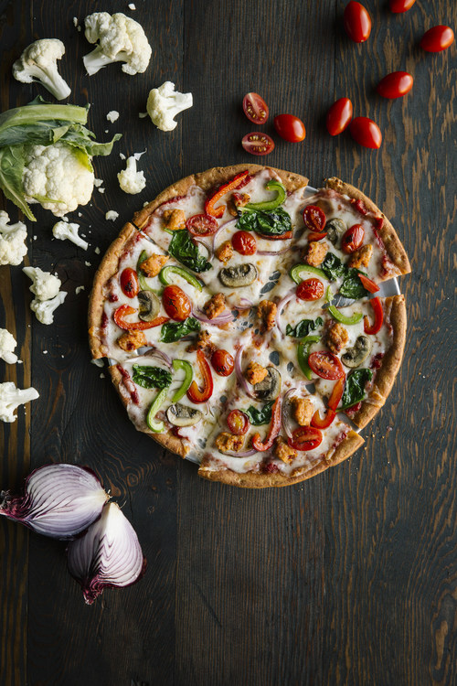 Due to popularity, Pie Five Pizza Co. makes fast, low-carb, cauliflower pizza crust a permanent addition to the menu. (PRNewsfoto/Pie Five Pizza)