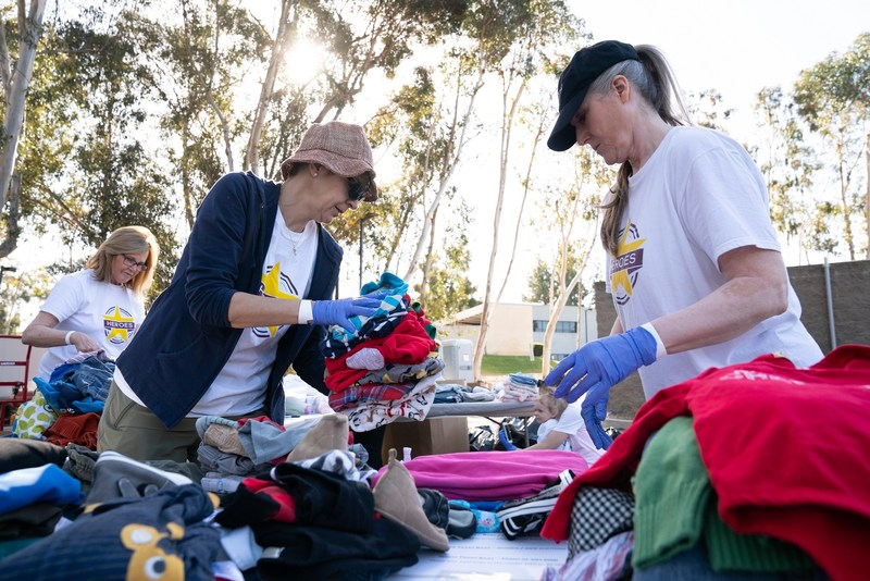 Bridgepoint Education and Ashford University volunteers sort clothing donations for STEP.