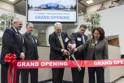 AM General President and CEO, Andy Hove (center) officially opening the AM General Technology and Engineering Center with (from left to right) City of Auburn Hills Mayor Pro-Tem, John Burmeister, AM General Chief Operating Officer Steve Zink, MEDC Executive Director, Michigan Defense Center, Sean Carlson, and Oakland  County Director, Economic Development & Community Affairs, Irene Spanos