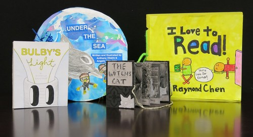 The city winners of the 2018 Ezra Jack Keats Bookmaking Competition are: (L to R) Bulby's Light, by Isabella Graziolo (grade 11, Fiorello H. LaGuardia High School, Manhattan); Under the Sea, by Anthony Hilaire and Angelo Ottaviano (grades 6 and 7, P.S. 77K, Brooklyn); The Witch's Hat, by Sarah Chen (grade 12, Stuyvesant High School, Manhattan); and I Love to Read, by Raymond Chen (grade 3, P.S. 164, Caesar Rodney, Brooklyn).