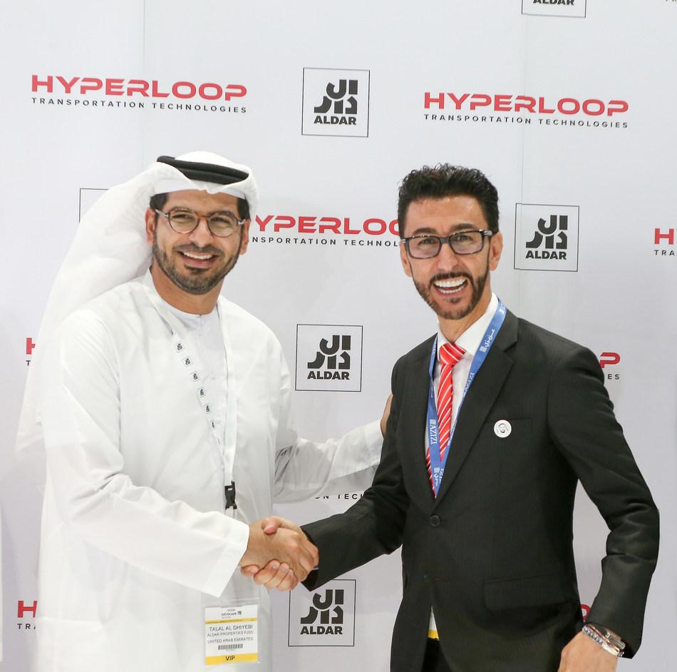 Bibop Gresta, Chairman, HyperloopTT and Talal Al Dhiyebi, CEO, Aldar sign historic agreement