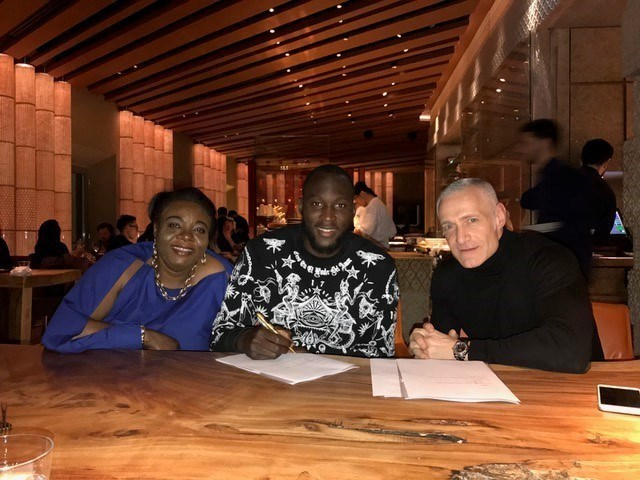 From left to right: Romelu's mother Adolphine, Romelu Lukaku, Roc Nation's Michael Yormark