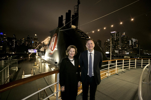 Her Majesty Queen Sonja of Norway and Daniel Skjeldam, CEO of Hurtigruten, stand together to mark the announcement of a new partnership with The Queen Sonja Print Award that will bring 600 pieces of curated art aboard the MS Roald Amundsen, the world's first hybrid battery powered ship, when it launches next year.