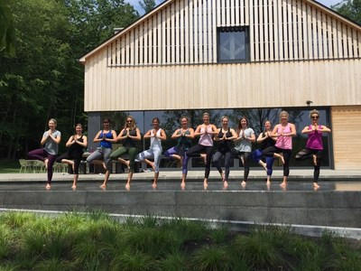 Grand Circle's young women leadership team takes part in an all-day yoga retreat at the company's Pinnacle Leadership Center in Kensington, NH.   Grand Circle's Wellness program provides company-wide health and well-being initiatives and creates opportunities and motivation to Associates to maintain a healthy lifestyle.  Its Boston headquarters offers a fully-equipped fitness facility, fitness classes,  meditation, reiki, acupuncture, free chair massages, quarterly wellness challenges, health screenings, seminars, fairs, and coaching.