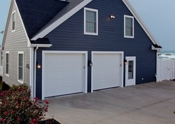 Garage doors are one of the four vulnerable areas of the home during severe weather. Selecting a garage door that passes impact and air pressure testing can help protect a home. (Photo courtesy of Haas Door)