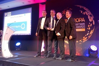 Mark Mamone from Serco (centre left) and Ed Winfield (centre right) from Content Guru receive the award at the Ceremony in the Royal Garden Hotel, London (PRNewsfoto/Content Guru)