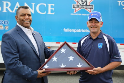 (Pictured left to right) Raymond Byrd, PepsiCo Senior Director, Fleet, and Mike Bedell, PepsiCo driver for first leg of Rolling Remembrance relay route, loading the flag onto the truck