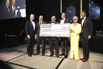 """Aaron's, Inc. launched """"Aaron's Scholars Program"""" with a $1 million gift benefiting 20 Morehouse College students, first in their families to enroll in college. (L to R): Aaron's, Inc. General Counsel and Foundation President Robert Kamerschen; Morehouse College President David Thomas; Aaron's Chief Operations Officer John Smith; Morehouse College Board Trustee Harold Martin Jr.; Morehouse College Board Trustee Billye Suber Aaron; Morehouse College Alumnus, TV Host and Songwriter Derek Watkins"""