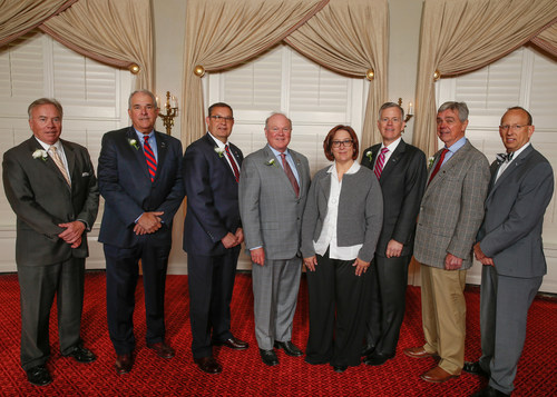 William H. Hayter, second from left, pictured with VHCC President Gene C. Couch Jr., and Laura Pennington as well as other members of the Bank's executive team and Board.
