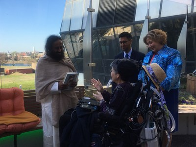 Sri Sri Ravi Shankar, global peace ambassador, humanitarian and spiritual leader, speaks with Jeni Stepanek and co-chairs of the newly formed provider wellness committee in the Bunny Mellon Healing Garden at Children's National Health System.
