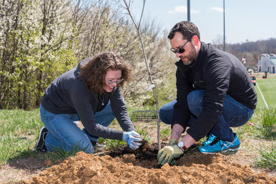 Some of the INTUS Team planting trees for the celebratory launch of One Window, One Tree