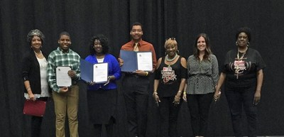 Black Heritage Festival representatives with Scholarship Committee Chairperson Theresa Garrett and CITGO Government & Public Affairs representative Jessica Marcantel awarding student scholarship recipients