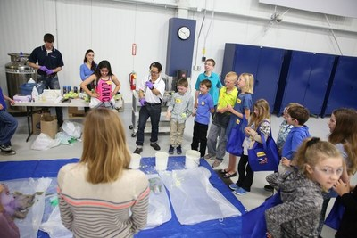 Children attending the 2017 Bring Your Child To Work Day participating in a dry ice science experiment.