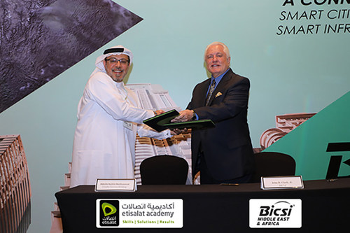 """""""Shown completing the signing of the Etisalat Academy – BICSI ADTP agreement is Abdulla Hashim Banihammad, CEO, Etisalat Services Holding, and John D. Clark, Jr. Executive Director and CEO, BICSI."""""""