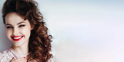 ROMANTIC TENDRILS: Side-swept curls prom hairstyle for long hair