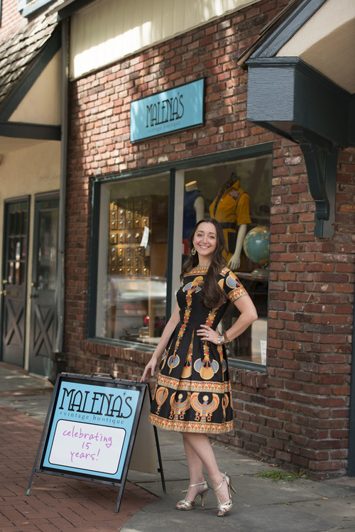 Malena Martinez outside her vintage clothing boutique that is celebrating 15 years in sustainable, ethical business.