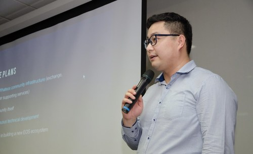 Roger Zhou, Security Manager, WhatEOS, introduces WhatEOS to the audience at the Pertside Center