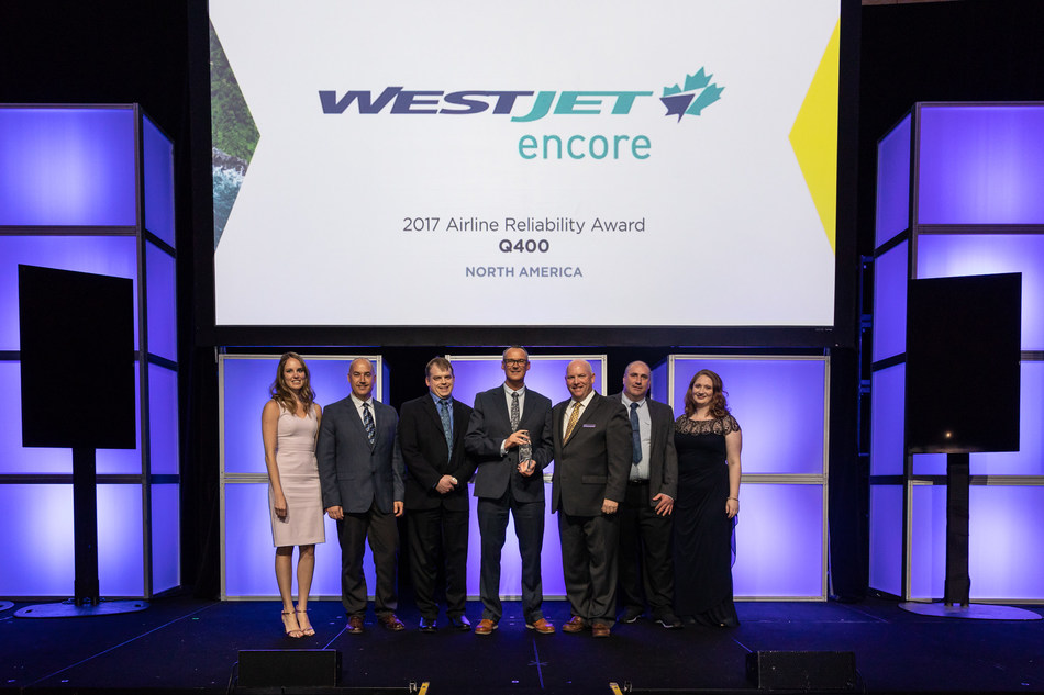 WestJet Encore announced it has been named a winner in the Bombardier Commercial Aircraft's 2017 Airline Reliability Performance awards (left to right: WestJet Encore Reliability Analyst, Ashlee Tanner; WestJet Encore Lead Aircraft Maintenance, Neil Quinn; WestJet Encore Assistant Chief Pilot, Dave Daniel; WestJet Encore Vice-President, Flight Operations, John Aaron; Vice-President and General Manager of Q400 Program and Customer Services for Bombardier Commercial Aircraft, Todd Young; WestJet Encore QA, Jeff MacFarlane; WestJet Encore Reliability Program Manager, Margaret Haswell) (CNW Group/WESTJET, an Alberta Partnership)
