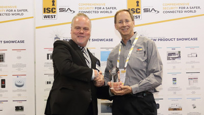 Rand Price (left), COO of the Security Industry Association, presents the New Product Showcase (NPS) award to Paul Skoog, senior product line manager for Microsemi.
