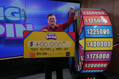 Terry Restoule of North Bay celebrates after spinning THE BIG SPIN Wheel at the OLG Prize Centre in Toronto to win $400,000. Restoule won a top prize with OLG's INSTANT game – THE BIG SPIN. (CNW Group/OLG Winners)