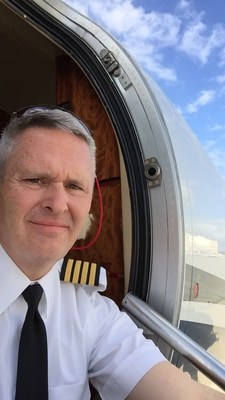 Captain Brandt at the entry door of a Cessna Citation Excel