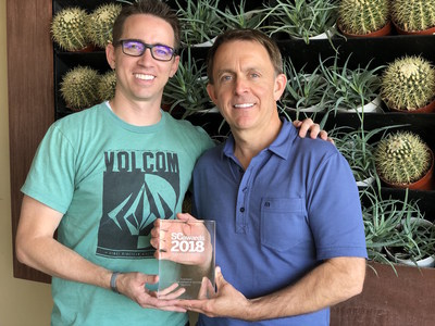Ammon Curtis, SVP of product and marketing, and Drew Smith, founder and executive chairman, hold InfoArmor's SCMag Award for Best Threat Intelligence Technology