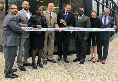 Photo from left to right:  Charles Lockley, Carver Head of Portfolio Management; Steven Berrios, Carver Commercial Relationship Manager; Vedelyn Davis, Carver Retail District Manager; John Fitzpatrick, Carver Chief Operating Officer; Victor Taliaferrow, Carver Branch Manager for Crown Heights; Michael T. Pugh, Carver President & CEO; Stephanie Wilchfort, Brooklyn Children's Museum President & CEO; & Niles Stewart, Carver Head of Commercial Lending