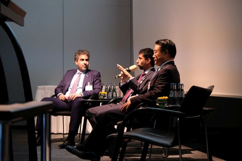 H.E. Eng. Suhail Mohamed Faraj Al Mazrouei, UAE Minister of Energy and Industry, speaks to invited guests in Hannover, as Badr Al-Olama (left) and LI Yong, Director General of the United Nations Industrial Development Organization, UNIDO (right) look on. (PRNewsfoto/Mubadala)
