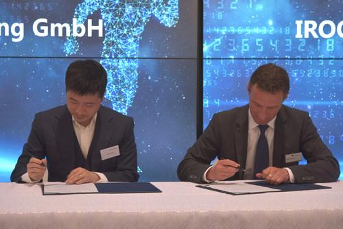 Allen Liang, president of IROOTECH, signed along with Martin Knötgen, CEO of Putzmeister